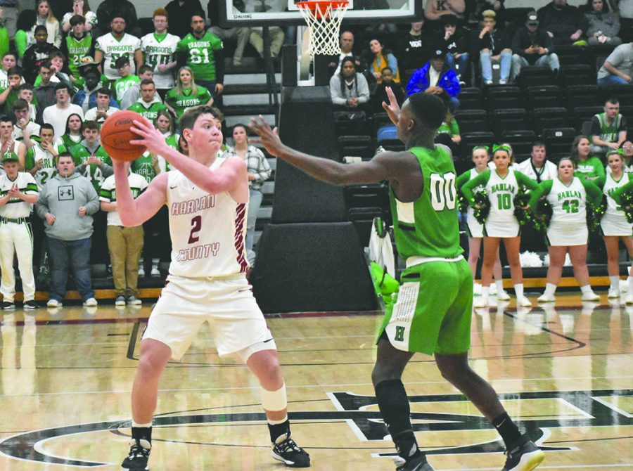 Two of the 13th Region's elite younger players, Harlan County's Trent Noah and Harlan's Jordan Akal, are pictured during the 52nd District Tournament. Both players are listed on the Enterprise All-Region Team.