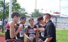 Hunter Middleton, Ryan Joseph, Ben Graham and David Lee talked with Harlan County coach Ryan Vitatoe during the 2010 state meet.