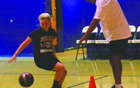 Back in Clover Fork, Hicks leads basketball camp