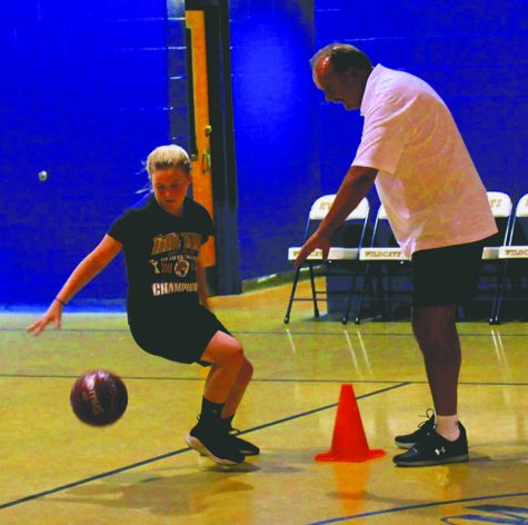 Back in Clover Fork, Hicks leads basketball camp