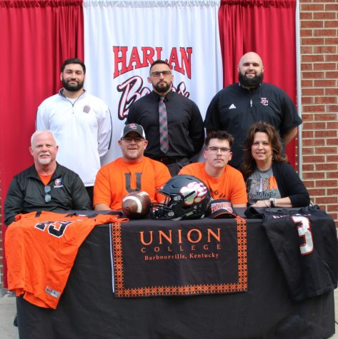 Harlan County quarterback Jacob Wilson signed with Union College on Wednesday. Pictured with Wilson are his parents, Shelby and Chrissy, and Union coach John Luttrell, along with Harlan County coach Eddie Creech and assistant coaches Scotty Bailey and Zach Caldwell.