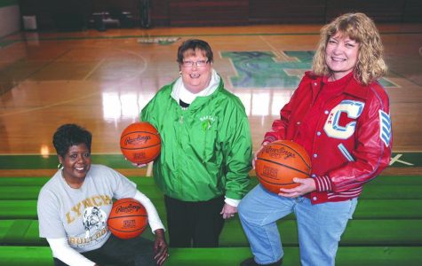 Kathy Thomas (left), Maralee Holder and Kim Kelley are pictured in the Harlan gym, where they led their respective teams in the first girls 52nd District Tournament in 1975.