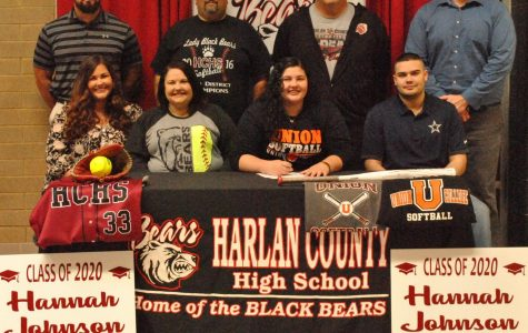 Harlan County's Hannah Johnson signed recently to continue her softball career at Union College. Pictured with Johnson are her parents, Everett and Lori Johnson; her siblings, Reagan and Shawn; HCHS assistant principals Eddie Creech and Mike Hensley and HCHS coach Tim McElyea.