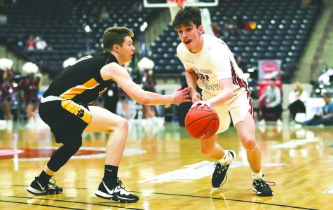 Harlan County guard Tyler Cole, a senior next season, worked around Clay County's Jacob Curry in last year's 13th Region Tournament. The Black Bears are among the eight teams invited to next season's WYMT Mountain Classic.
