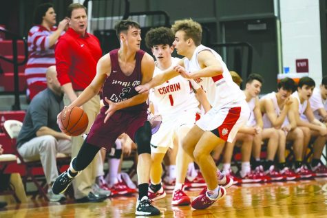 Harlan County guard Taylor Spurlock, pictured in action last season against Corbin, will continue his basketball career at the Division II level in college at Colorado School of Mines.