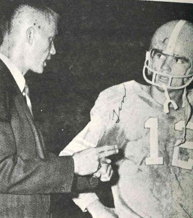 James+A.+Cawood+quarterback+Tim+Saylor+talked+with+coach+Wendell+Wheeler+during+the+1968+season.