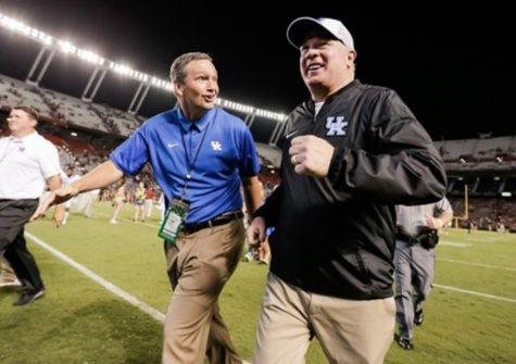 Mitch Barnhart and Mark Stoops are taking careful steps as schools re-open to allow athletes back on campus for voluntary workouts next month.