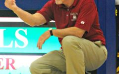 Mike Jones won four regional championships and 613 games in his coaching career.