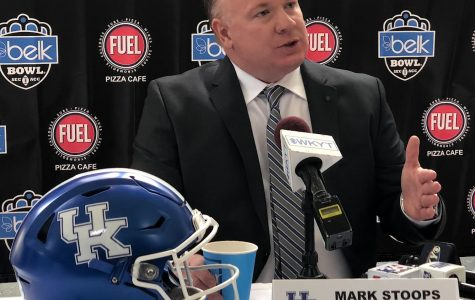 Kentucky coach Mark Stoops is keeping an eye on his team's progress remotely this summer.