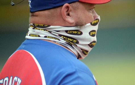 421 Vendors Mall coach Brad Shelton wore a mask as the Harlan Little League practiced social distancing and safety. The league stopped play this weekend after two weeks of action.