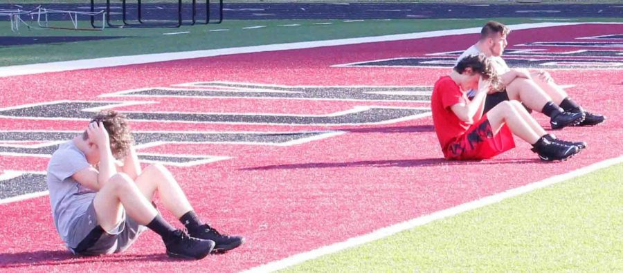 Members of the Harlan County football team went through workouts earlier this summer.