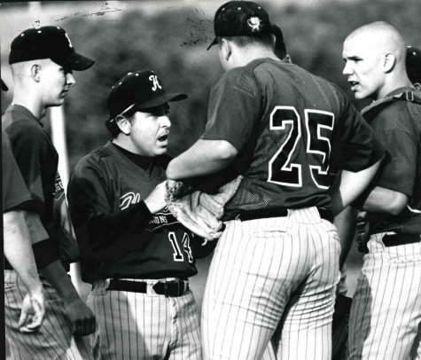 Harlan coach Murph Howard talked with (from left) Charlie Rutledge, Thomas Goss and Tim Rutledge during a game in the mid 1990s. Howard led the Dragons to a 13th Region title in 1996 and made the last trip to the sectional tournament for a county team.