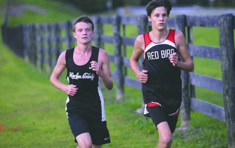 Caleb Brock (left) is expected to be a leader for this year's Harlan County cross country team.