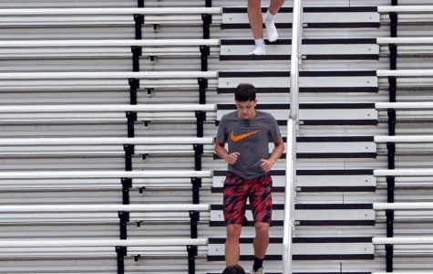 Harlan County's Josh Swanner (top), Gavon Spurlock and Andrew Johnson worked their way down the bleachers during a practice session earlier this week.