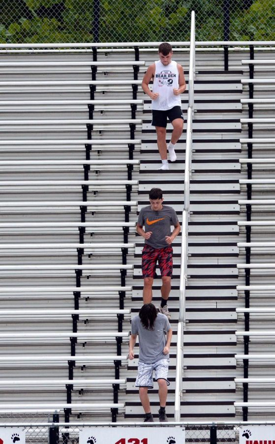Harlan+County%27s+Josh+Swanner+%28top%29%2C+Gavon+Spurlock+and+Andrew+Johnson+worked+their+way+down+the+bleachers+during+a+practice+session+earlier+this+week.