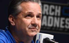 Kentucky coach John Calipari is making the best of things while his team is in a