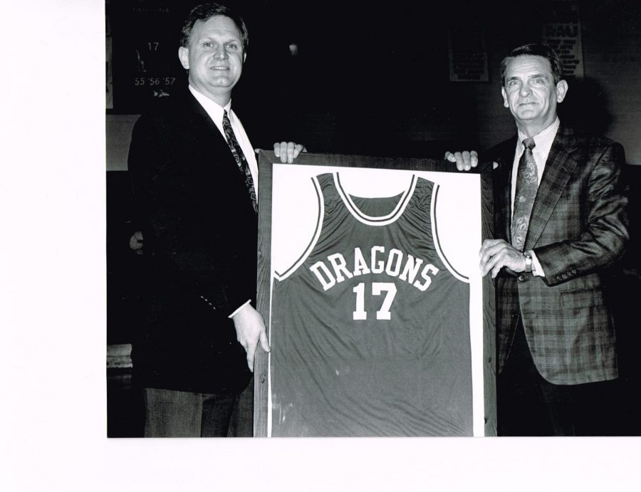 Former Harlan basketball standout Dickie Parsons had his jersey retired during ceremonies at Harlan High School in the 1990s. Parsons, pictured with Harlan Independent Schools Superintendent David Johnson, was a second-team all-stater in 1957 before going on to play basketball and baseball at the University of Kentucky. Parsons was the head baseball coach at UK from 1970 to 1972 and was an assistant coach from 1970 to 1980 with the UK basketball program, first with Adolph Rupp and then under Joe Hall.