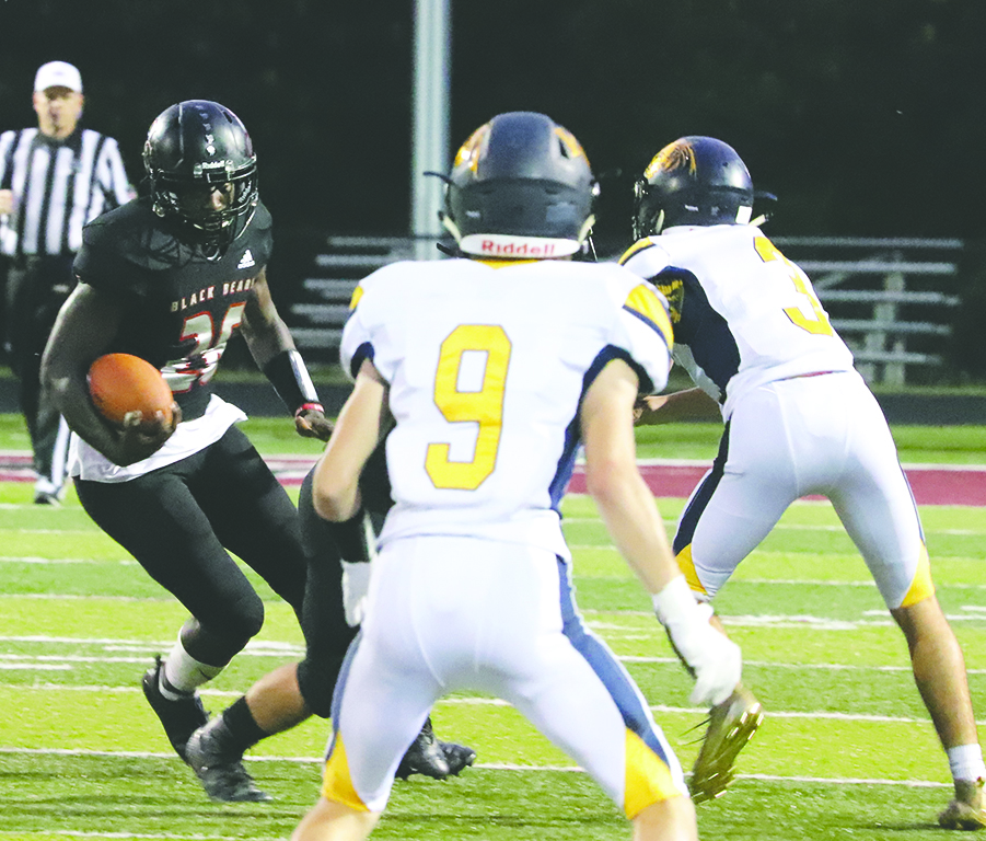 Harlan+County+running+back+Demarco+Hopkins+picked+up+yardage+in+a+game+last+season+against+Knox+Central.