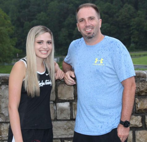Harlan County High School senior Abby Vitatoe is pictured her father, HCHS cross country coach Ryan Vitatoe before a recent practice session.