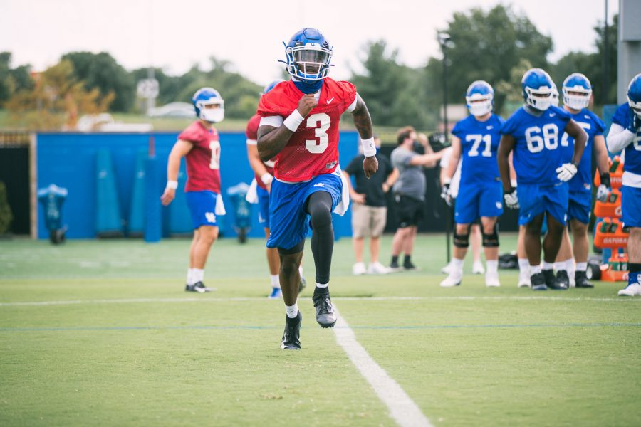 UK quarterback Terry Wilson took part in a running drill during practice Tuesday.