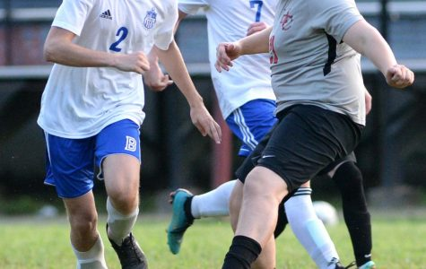 Harlan County's Isaac Taulbee worked to advance the ball in action earlier this season. The Bears fell 1-0 to Letcher Central and will return to action Monday at home against Barbourville.