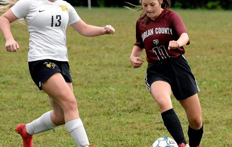 Harlan County's Riley Key worked down the field against Middlesboro's Amber Mullins in district action Tuesday. HCHS won 3-0.