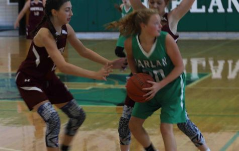 Harlan's Addison McLain looked for help against Pineville's press on Saturday. The Lady Lions grabbed an early lead on the way to a 46-10 win.