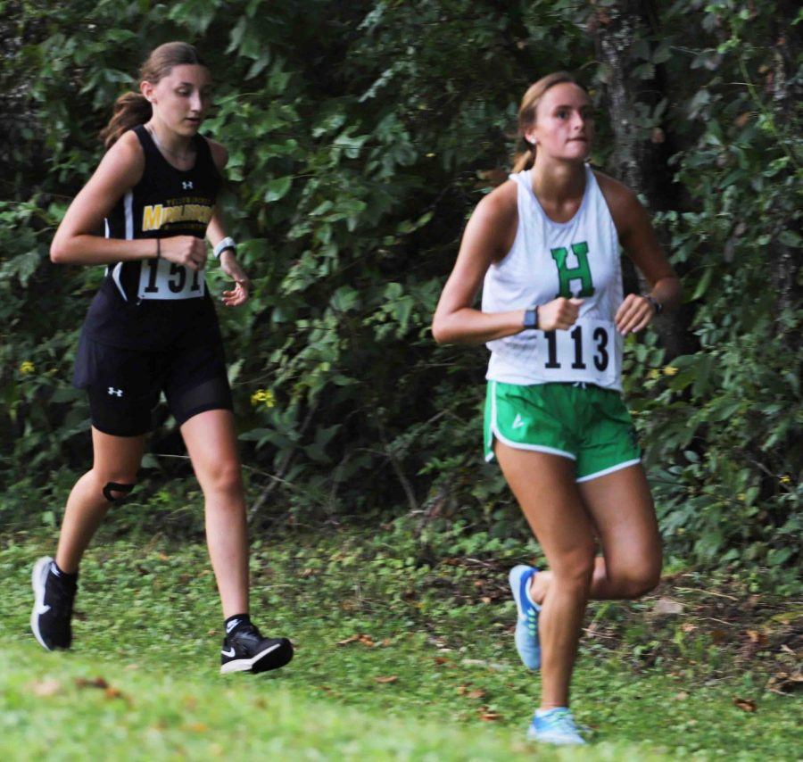 Harlan's Ella Morton, pictured in action earlier this season, qualified for the Class A state meet by finishing 12th in the Region 5 meet.