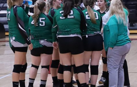The Harlan Lady Dragons talked during a timeout earlier this season. The Lady Dragons defeated Middlesboro on Saturday and Monday and will take a two-game winning streak into the district tournament.