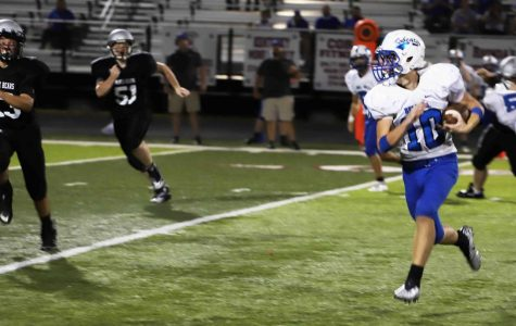 Bell County's Jackson Walters picked up yardage after a catch as Harlan County's Hunter Napier and Brayden Smith gave chase in middle school football action Thursday.