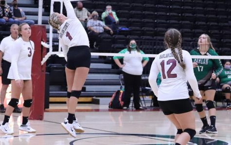 Harlan County's Lilly Caballero returned the ball in district action last week against Harlan. The Lady Bears won in five sets on Saturday at Harlan.