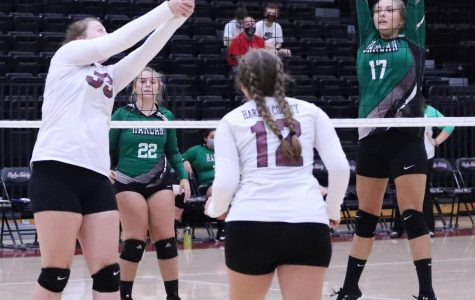 Harlan County's Lindsey Browning knocked the ball over the net as Harlan's Annie Hoskins waited in district action Tuesday. Browning had 12 kills in the Lady Bears' four-set victory.