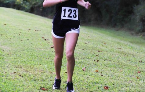 Harlan County eighth-grader Peyton Lunsford approached the finish line Tuesday as she won the opening home race at HCHS.