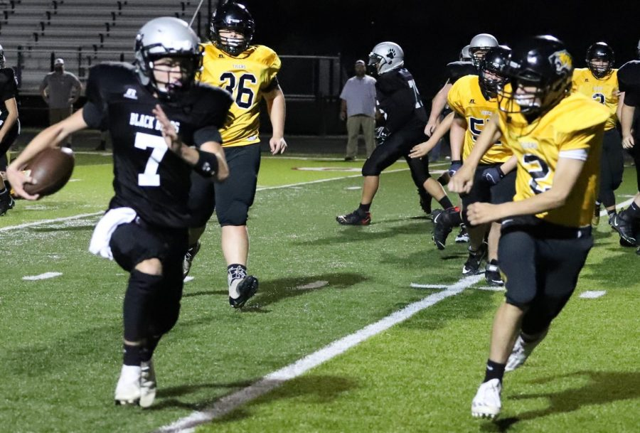 New Harlan quarterback Connor Daniels scored on a 6-yard run in Tuesday's game against Clay County.