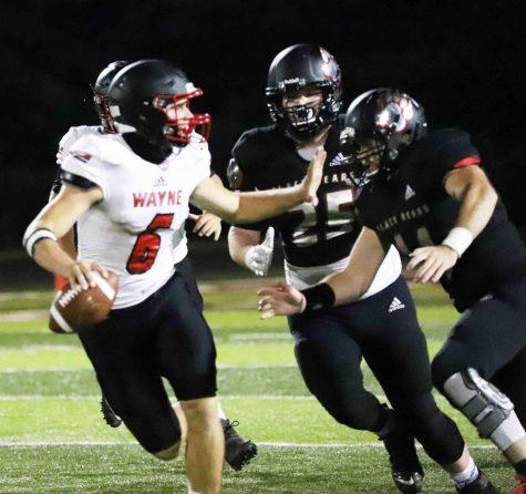 Josh Turner and Hunter Helton pressured Wayne County quarterback Brody Weaver during Friday
