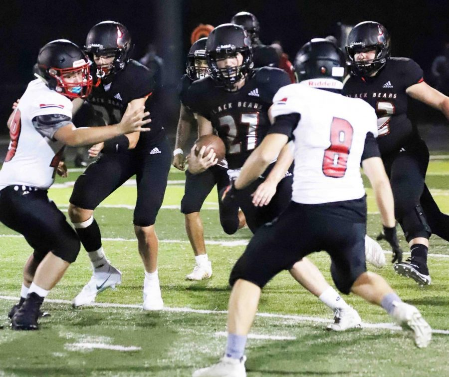 Josh+Swanner%2C+pictured+in+action+earlier+in+the+season%2C+scored+three+touchdowns+in+Harlan+County%27s+win+over+Clay+County+last+week.