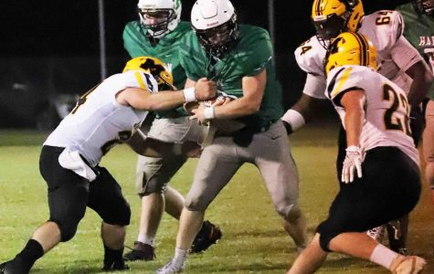 Harlan running back Triston Cochran was surrounded by defenders in a game against visiting Middlesboro. The Dragons travel to Berea on Friday.