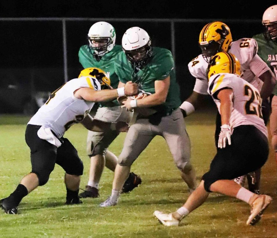 Harlan+running+back+Triston+Cochran+was+surrounded+by+defenders+in+a+game+against+visiting+Middlesboro.+The+Dragons+play+host+to+Knott+Central+on+Friday.