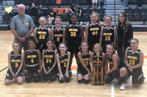 Middlesboro won the All A Conference championship on Saturday in the fifth- and sixth-grade division. Team members include, from left, front row: Madalynn Knack, Lyla Scearse, Carrie Wilson, Abigale Jackson, Morgan Martin, Millie Roberts, Trinity Derossett and Alysia Smith; back row: coach Donny Brock, Emily Parsons, Tilly Hoskins, Kiely Taylor, Jenna Baker, Lillie Partin and coach Kristen Brock.