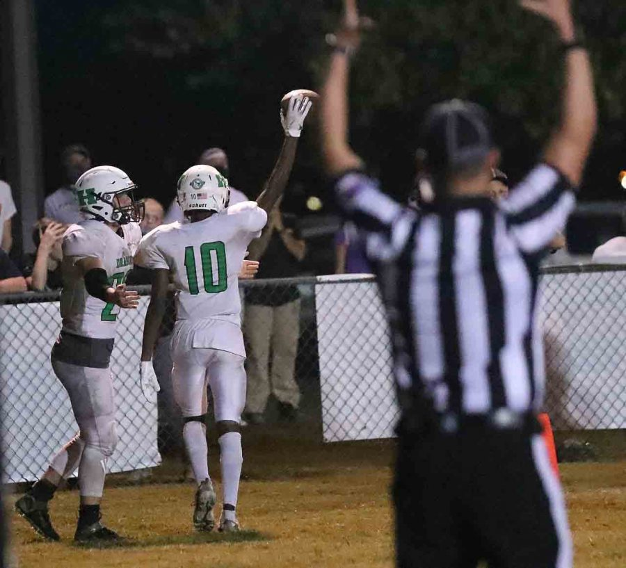 Harlan receiver Darius Akal celebrated after scoring a touchdown to give the Green Dragons a 22-20 win at Berea on Friday.
