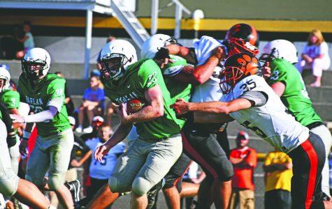 Harlan junior running back Jayden Ward battled for yardage in action last season.