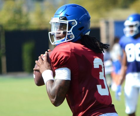 Kentucky quarterback Terry Wilson threw a pass during an open practice last year.