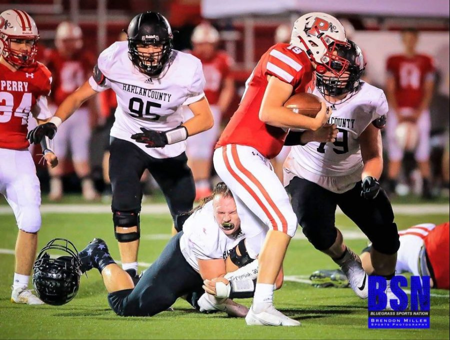 Hunter+Blevins+lost+his+helmet+making+a+tackle+in+last+weeks+game+at+Perry+Central.+Brett+Roark+%2895%29+and+Connor+Blevins+%2879%29+were+on+their+way+to+help.+The+Bears+travel+to+Anderson+County+on+Friday.