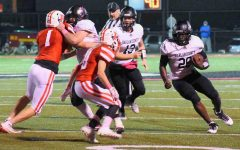 Harlan County running back Demarco Hopkins picked up yardage in Friday's game at Perry Central.