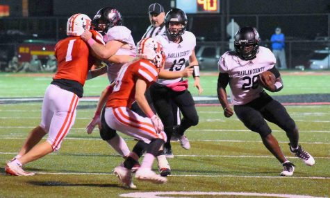 Harlan County running back Demarco Hopkins picked up yardage in Friday