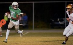 Harlan freshman Darius Akal picked up a big gain on a kickoff return in Friday's game against Pineville. The visiting Mountain Lions won 29-8 with the help of six Harlan turnovers.