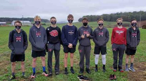 The Harlan County boys cross country team placed third in the Region 5 meet on Saturday. Team members include, from left: Caleb Brock, Cooper McHargue, Andrew Yeary, Matt Yeary, Lucas Epperson, Austin Crain and Breydy Daniels.