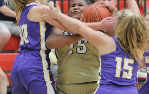 Drucilla Brown was surrounded by Wallins' Whitley Teague and Savannah Hill in the season-opening games Monday at James A. Cawood Elementary School.