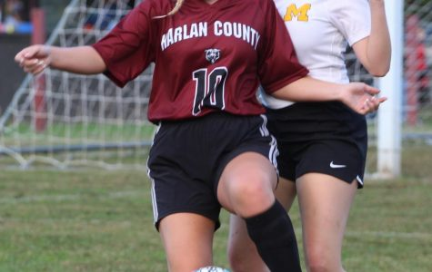 Harlan County's Hayley Key worked around a Middlesboro defense in district soccer action Monday. The Lady Jackets advanced with a 1-0 victory.