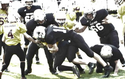 Harlan County's Jason Fultz battled for yardage in action Saturday against visiting Bourbon County. Fultz had a touchdown run in the Bears' 32-6 victory.